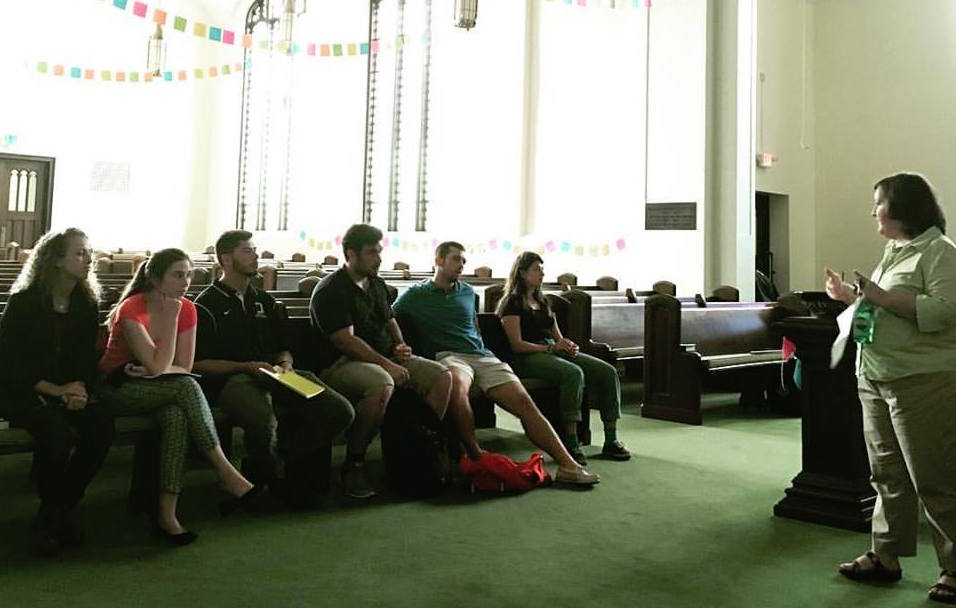 Music Director explains church history to students