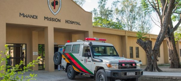 Photo of Mwandi Mission Hospital with ambulance out front