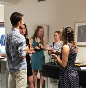 Early-career alumni networking during Homecoming weekend in the Center for Career Development
